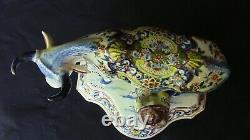 A lovely Dutch Delft Polychrome Cow With Milker
