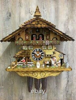 Cuckoo Clock Black Forest house with moving cow milker and turnin. HO 8656T NEW
